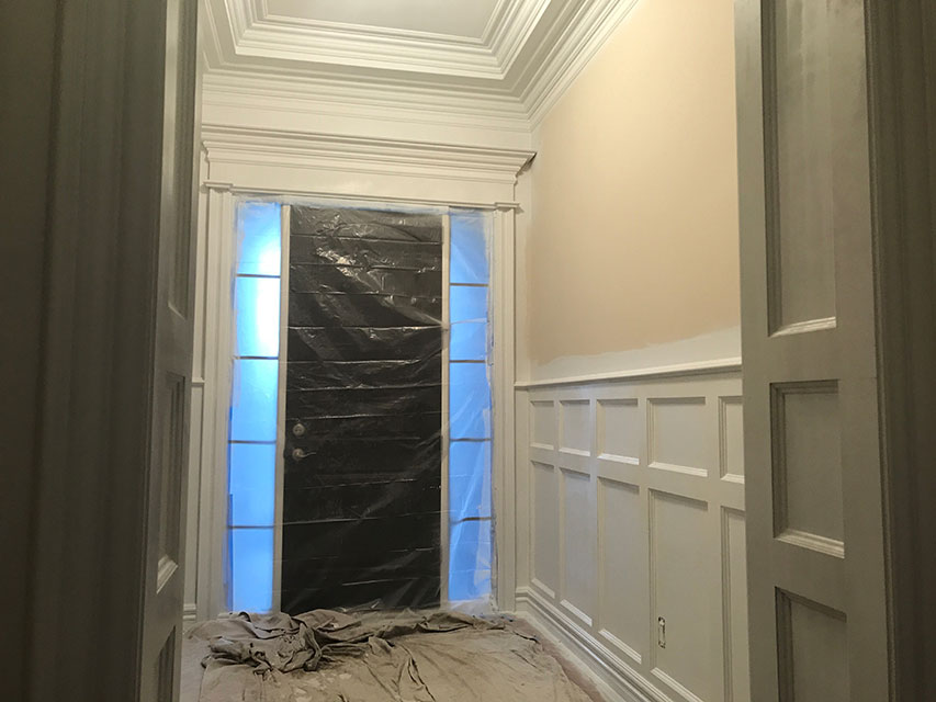 home entryway with wainscoting installation