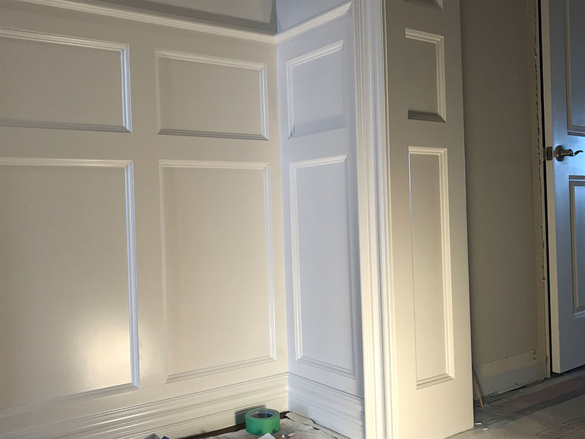 closeup of finished white wainscoting